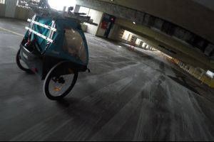 unicycle stroller down a parking garage